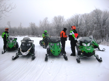 Arctic Cat Engineers stop to compare notes on the test sleds