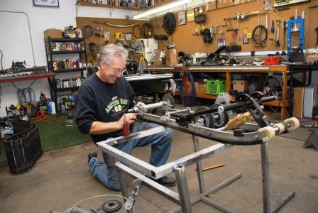 Nelson working on the Arctic Cat el tigre CC skidframe