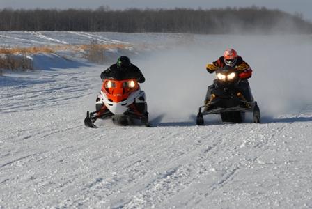Arctic Cat draggin' a Ski-Doo