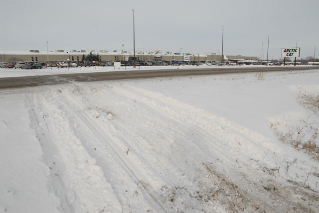 Snowmobile tracks outside of the Arctic Cat factory
