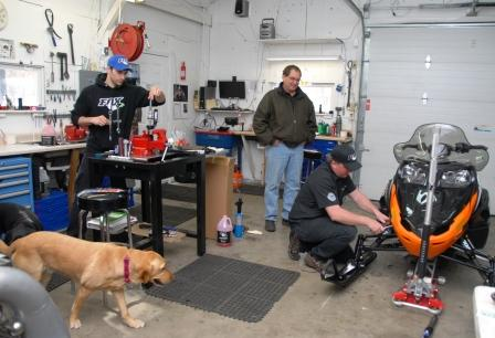 Ryan Greening (l), Eric Loge, Rick Strobel (kneeling) and Lucy dog