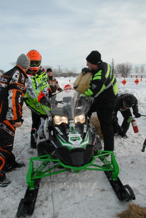 Arctic Cat Product Manager, Joey Hallstrom getting fuel