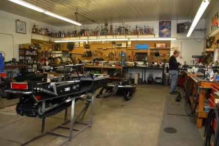 Inside Nelson's race shop, Arctic Cat stuff everywhere