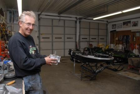 Brian smiling at the ugly grind job I did on the cylinder for Joey's sled