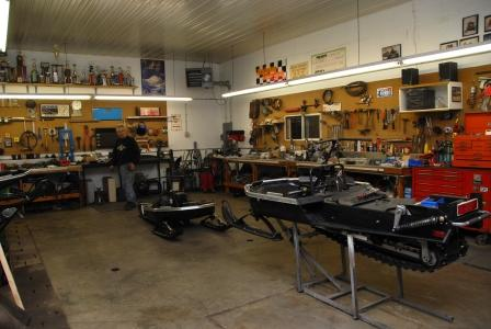 Two of the three Arctic Cat el tigre Cross-Country sleds in Nelson's shop