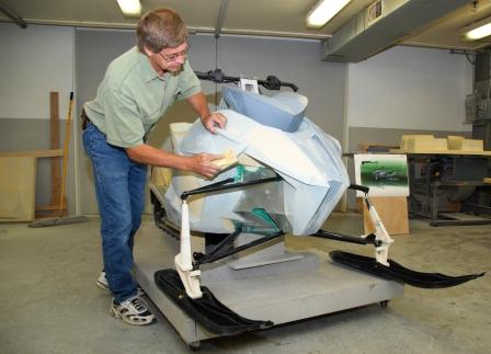 Nelson, fabbing a foam model of what would become a 2012 Arctic Cat