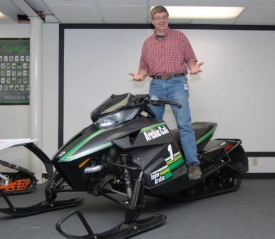 Nelson poses with a mocked-up 2012 Arctic Cat 50th Anniversary model, wearing his favorite shirt
