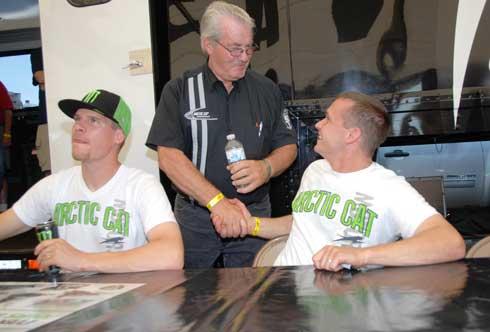 Roger Skime gets a handshake from P.J. Wanderscheid while Tucker Hibbert looks...weird.