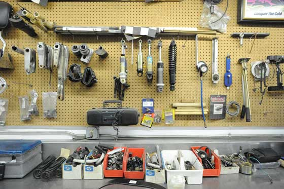 A well-organized snowmobile shop wall
