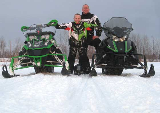 Me and my sone Calvin on a snowmobile ride last winter