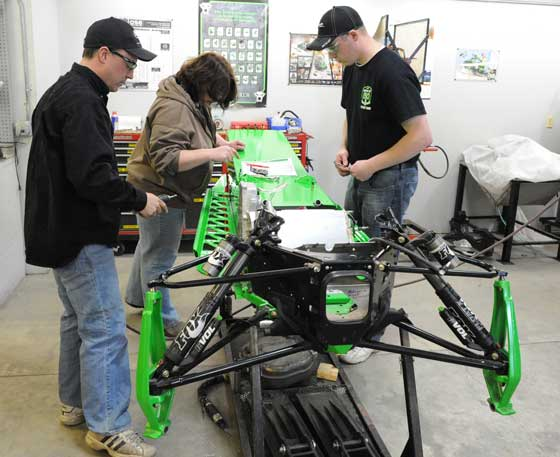 Brian Dick, Michelle McCraw and Zane in Arctic Cat Engineering