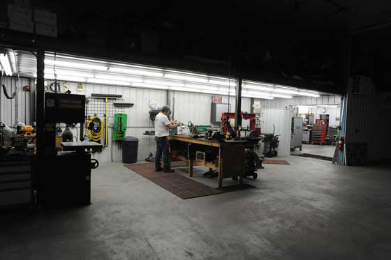 Kirk Hibbert working late in his race shop