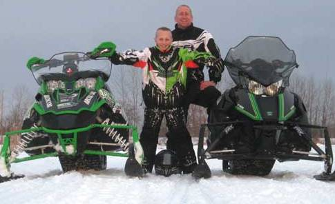 Me and my son Calvin on a snowmobile ride last winter