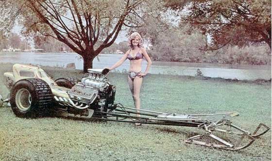 Summer snowmobile fun with bikinis and dragsters