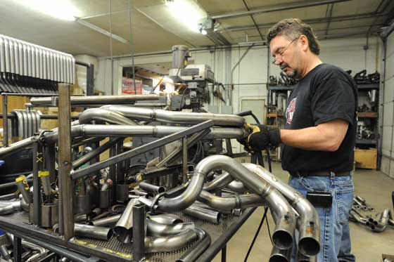 Steve Houle of Speedwerx welding a header