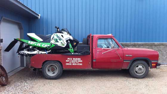 Towing an Arctic Cat Sno Pro race sled the old-fashioned way