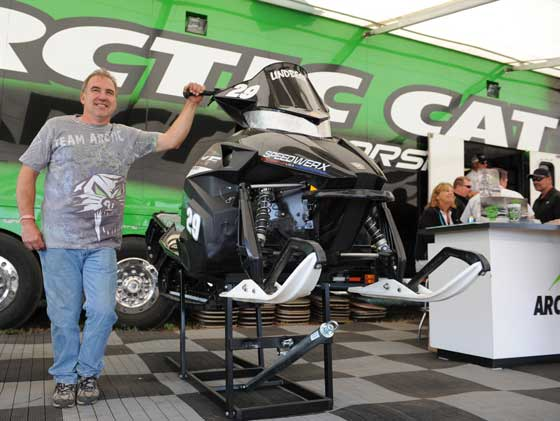 Team Arctic Cat racer Dale Lindbeck displays his sled in the Cat booth at Haydays