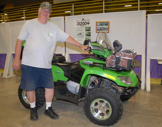 Curt Asche and his 2007 Arctic Cat TRV with 31K miles at the 50th Anniversary.