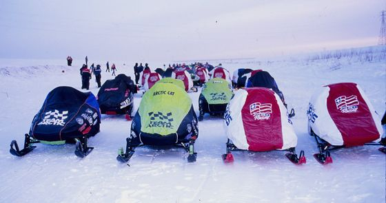 Race sleds lined up in Winnipeg at the 1996 I-500, by ArcticInsider.com