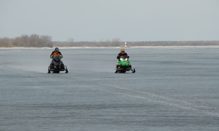 Arctic Cat's Larry Coltom and Ryan Hayes testing prototype sleds in 2010. Photo by ArcticInsider.com