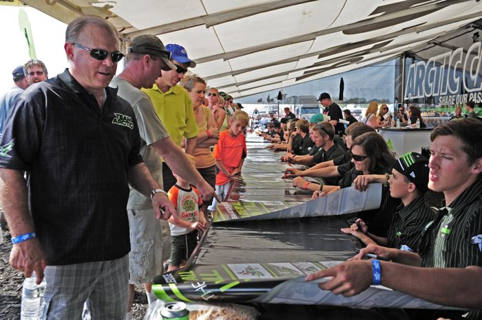 Arctic Cat President/CEO Claude Jordan getting Team Arctic autographs at Hay Days
