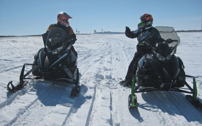 Arctic Cat's Brian Dick (R) and Roger Skime testing 2014 snowmobiles. Photo by ArcticInsider.com
