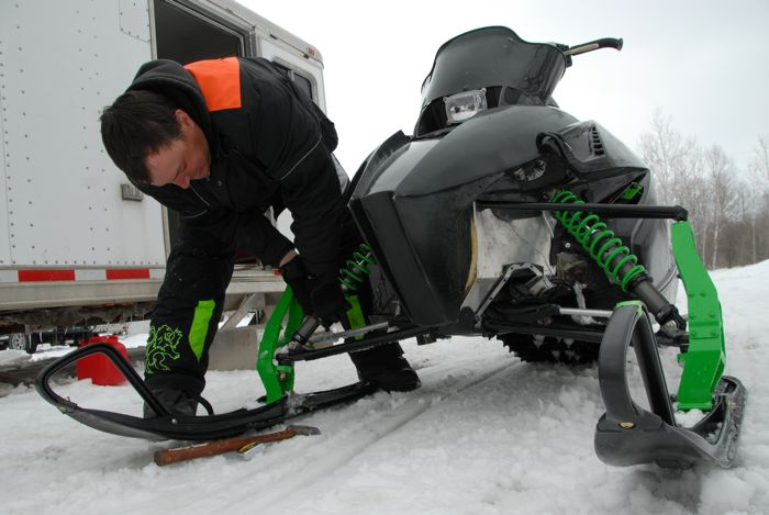 Arctic Cat racer-engineer Brian Dick with a prototype ProCross sled in 2009. Photo by ArcticInsider.com