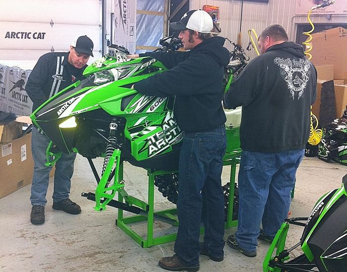 Brian Dick, Wes Selby and Hector Olson... working on race sleds.