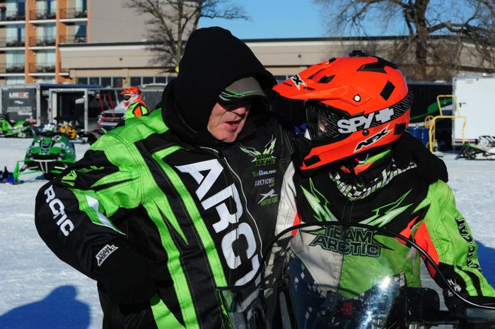 Arctic Cat's Roger Skime gives Cal Sandberg a few words of encouragement