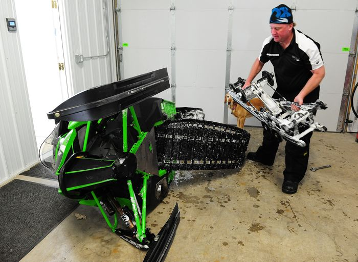 FOX's Rick Strobel swaps a skidframe in an Arctic Cat ZR 6000RR. Photo: ArcticInsider.com