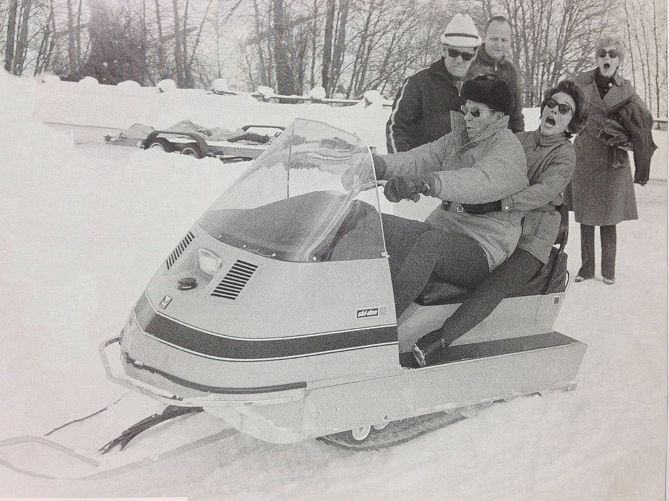 Ronald & Nancy Reagan hit the gas on a snowmobile.