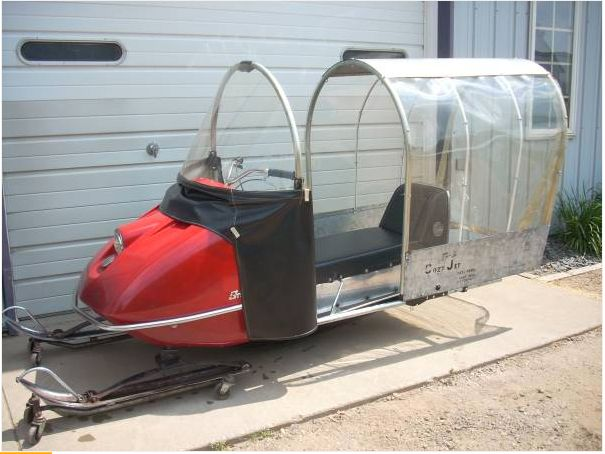 Vintage snowmobile with bubble kit.