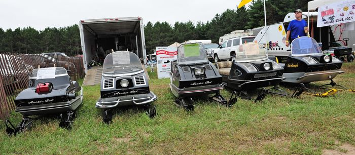 Litter of vintage Arctic Cats on display at Outlaws. Photo by ArcticInsider.com