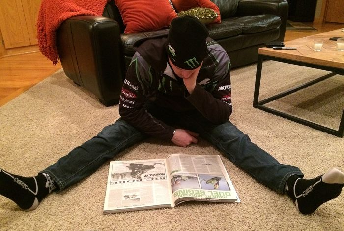 Tucker Hibbert reading about his first Pro win in Snow Week magazine. Photo by ArcticInsider.com