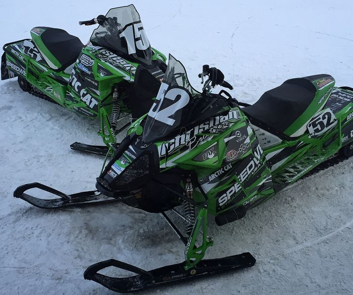 The #15 Arctic Cat of Brian Dick & Wes Selby, with the 52-sled of Ryan Simons & Zach Herfindahl
