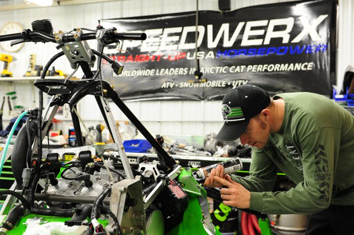 Wes Selby works on a 2015 Arctic Cat Soo sled in the Race Shop. Photo by ArcticInsider.com