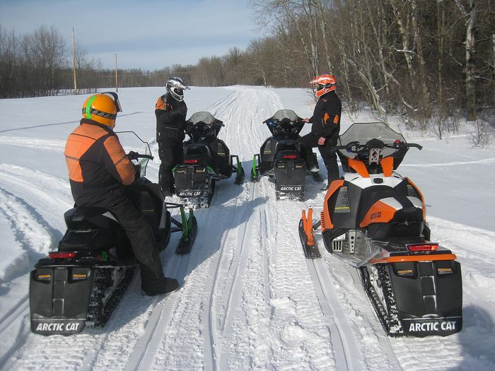 Arctic Cat engineers test-riding snowmobiles. Photo by ArcticInsider.com