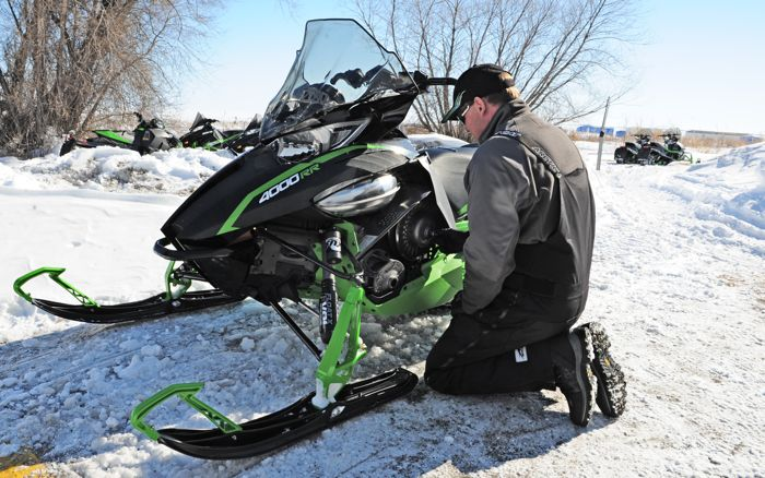 Arctic Cat snowmobile engineer Bart Magner calibrating a ZR4000RR. Photo by ArcticInsider.com
