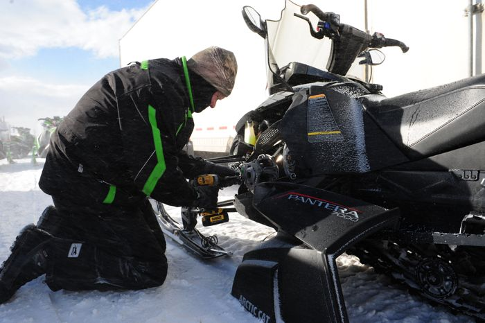 Arctic Cat snowmobile engineer Bart Magner calibrating a 2016 Pantera. Photo by ArcticInsider.com