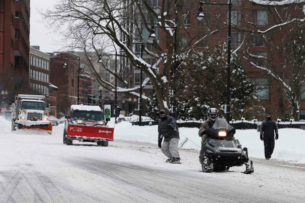 TGIF: The snowboard and snowmobile in the street edition.