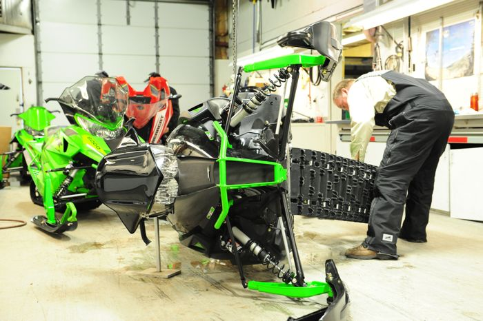 Arctic Cat engineer Jeff Olson working on 2016 rear suspension.