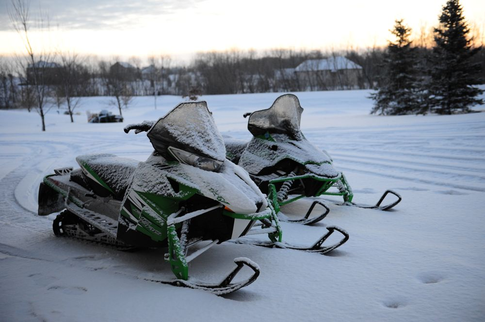 Arctic Cat snowmobiles ad daybreak, freshly coated. Photo by ArcticInsider.com