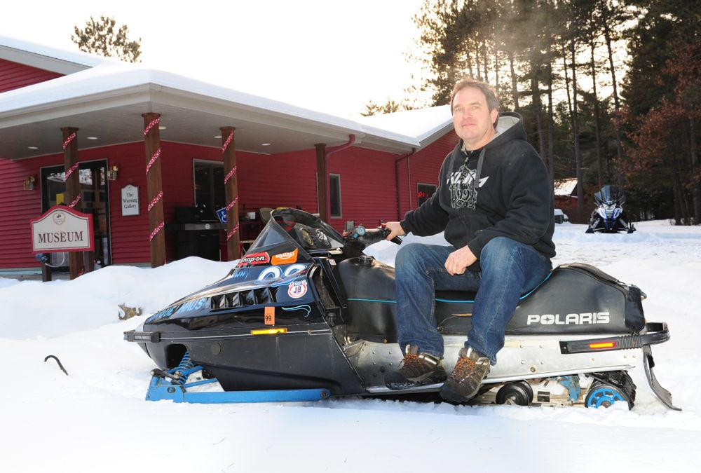 Jeremy Fyle with his '89 Polaris Indy at the snowmobile hall of fame. Photo ArcticInsider.com