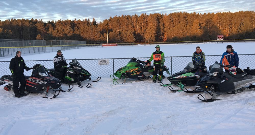 Students at Pequot Lakes, MN, High School ride snowmobiles to school.
