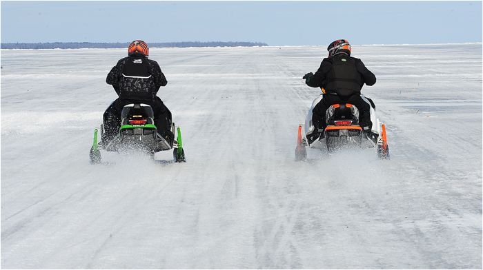 Jim Dimmerman (L) and Larry Coltom race Arctic Cat 9000 turbos. Photo by ArcticInsider.com
