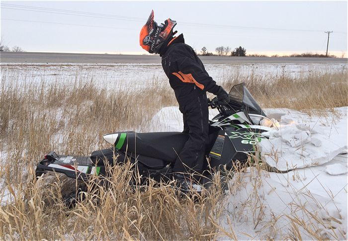 Sandberg is a professional snowmobile rider. Or not.