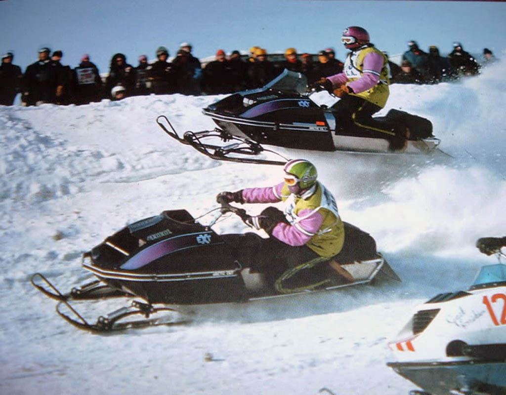 Vintage snow oval racing Arctic Cat EXTs.