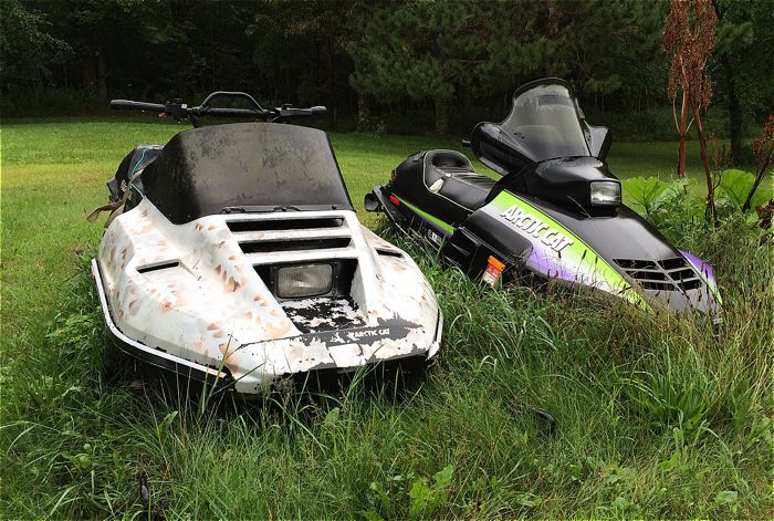 Arctic Cat's sitting alongside a garage. Photo by ArcticInsider.