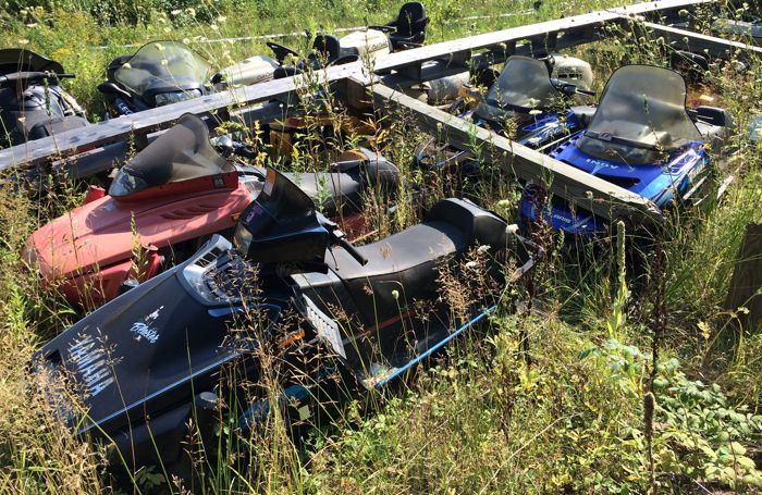 Old sleds in a ditch near Berglund, Mich. Photo by ArcticInsider.com
