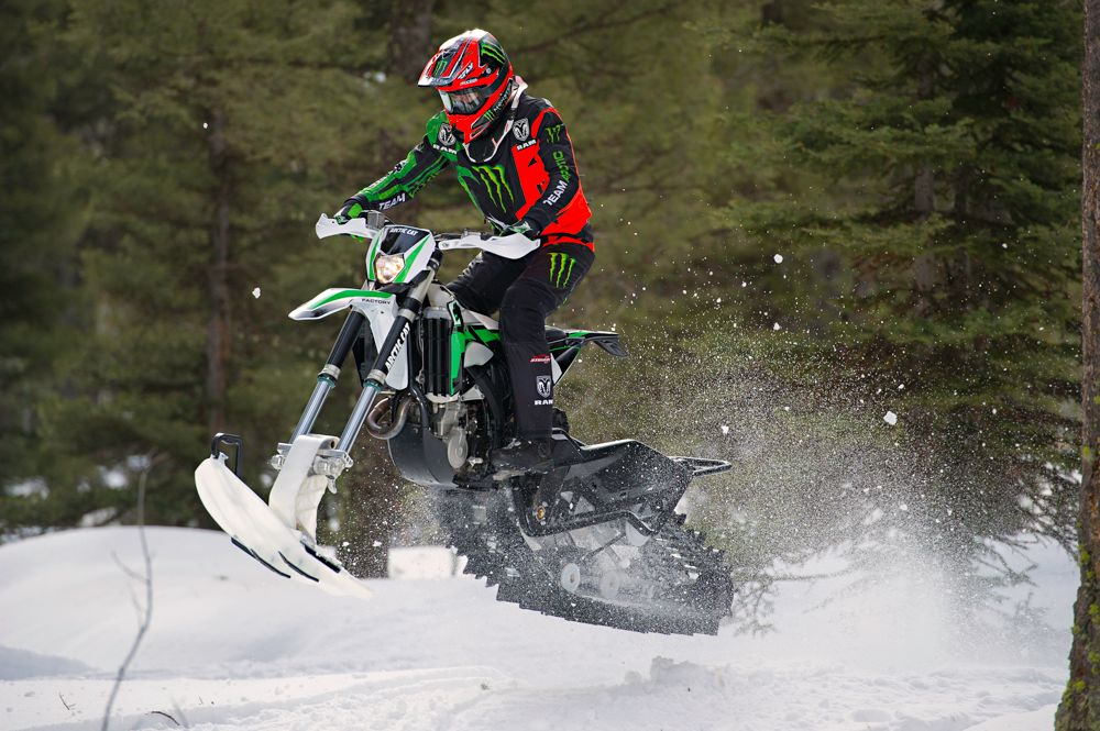 Tucker Hibbert jumping the Arctic Cat SVX 450 snow bike. ArcticInsider.com